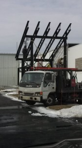 Erection crews put the finishing touches on the steel canopies.